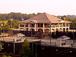 Racquet Clubhouse, image from afar of two courts and the two story clubhouse